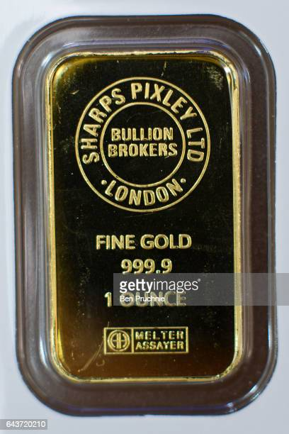 The Sharps Pixley Bullion Brokers logo is stamped on a 1 ounce block of gold at Sharps Pixley Bullion Brokers on December 15 2015 in London England...