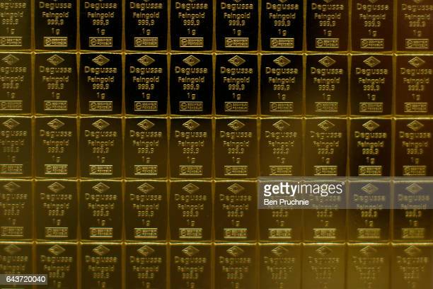 The Sharps Pixley Bullion Brokers logo is stamped on a set of 1g blocks of gold at Sharps Pixley Bullion Brokers on December 15 2015 in London...