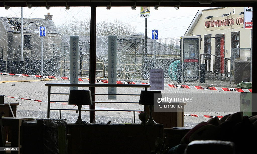 The shattered front window of a furniture shop is pictured near Newtownhamilton Police station in South Armagh, Northern Ireland, on April 23, 2010, after a car bomb exploded outside the police station. A car bomb has exploded outside a police station in Northern Ireland, injuring three people in the latest attack to rock the troubled province, police said. The blast in Newtownhamilton, County Armagh, happened at around 11:25 pm (2225 GMT) Thursday, said a spokeswoman for the Police Service of Northern Ireland. AFP PHOTO/Peter Muhly