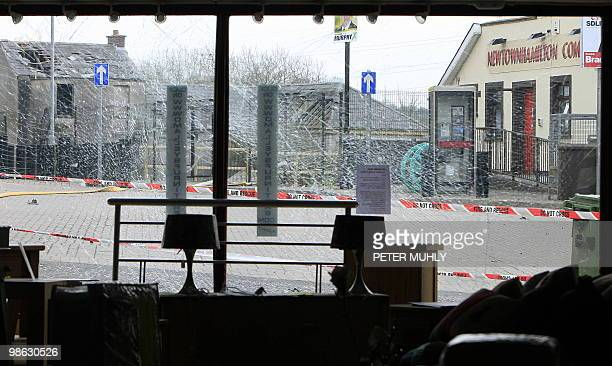 The shattered front window of a furniture shop is pictured near Newtownhamilton Police station in South Armagh Northern Ireland on April 23 after a...