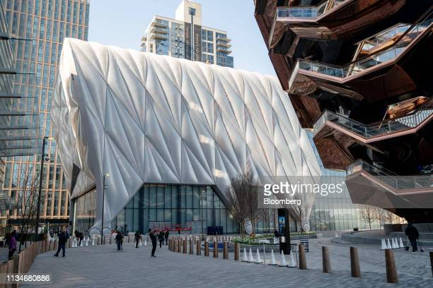 The Shed cultural center stands next to the Vessel sculpture by Thomas Heatherwick at Hudson Yards in New York US on Wednesday April 3 2019 After...