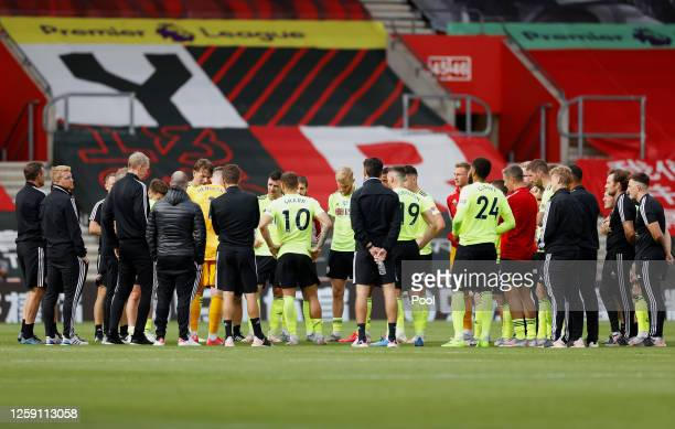 The Sheffield United team speak on pitch following the Premier League match between Southampton FC and Sheffield United at St Mary's Stadium on July...