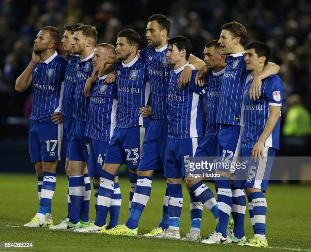 The Sheffield Wednesday team look on during the penalty shoot out during the Sky Bet Championship play off semi final second leg match between...