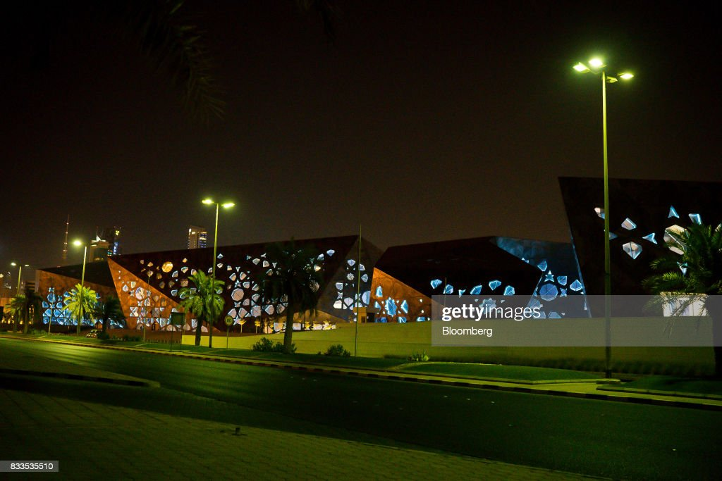 The Sheikh Jaber Al-Ahmad Cultural Center stands illuminated at night in Kuwait City, Kuwait, on Monday, Aug. 14, 2017. Kuwait will issue a tender to build the estimated $1.2 billion Dibdibah solar-power plant in the first quarter of 2018 as part of the countrys plans to produce 15 percent of power from renewable energy by 2030. Photographer: Tasneem Alsultan/Bloomberg via Getty Images