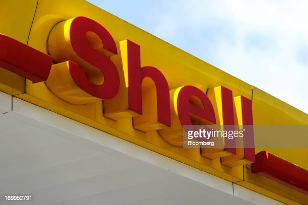 The Shell company logo sits on display at a gas station, operated by Royal Dutch Shell Plc, in Brussels, Belgium, on Tuesday, June 4, 2013. Royal...