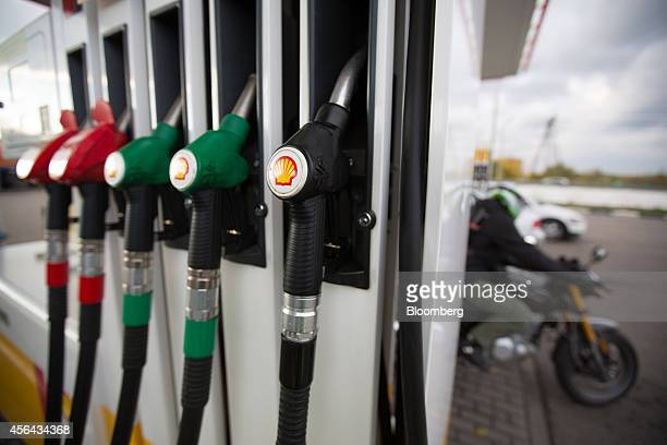 The Shell company logo sits on fuel pumps on the forecourt of a gas station operated by Royal Dutch Shell Plc in Moscow Russia on Tuesday Sept 30...