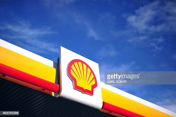 The Shell logo is pictured outside a Shell petrol station in central London on January 17, 2014. Shell issued a severe profits warning on January 17...
