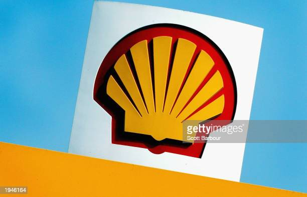 The Shell logo is shown at a Shell petrol station April 23, 2003 in London, England. Shell is facing a shareholder revolt over boardroom pay with...