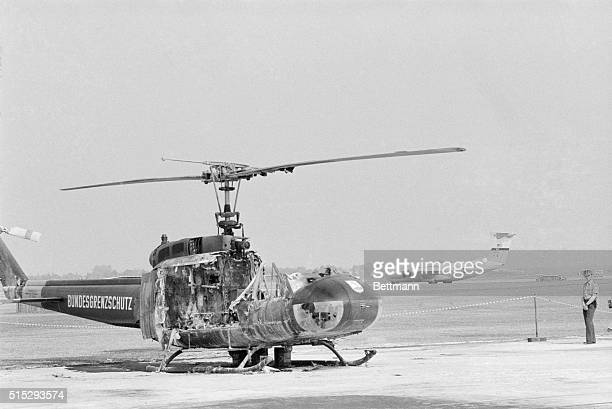 The shell of a helicopter destroyed by a terrorist's grenade sits at Fuerstenfeldbruck Air Base as the plane carrying the body of murdered...