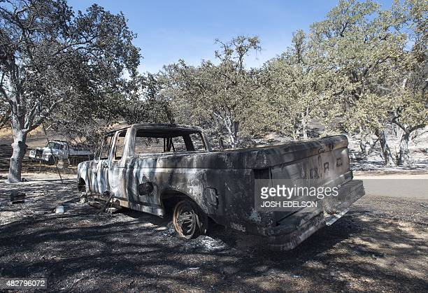 The shell of a truck sits after burning as a result of the Rocky fire near Clear lake California on August 02 2015 Thousands of firefighters battled...