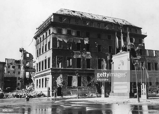 The shell of the Adlon Hotel in the Unter den Linden, Berlin still standing but windowless. Beside it is a large picture of Stalin.