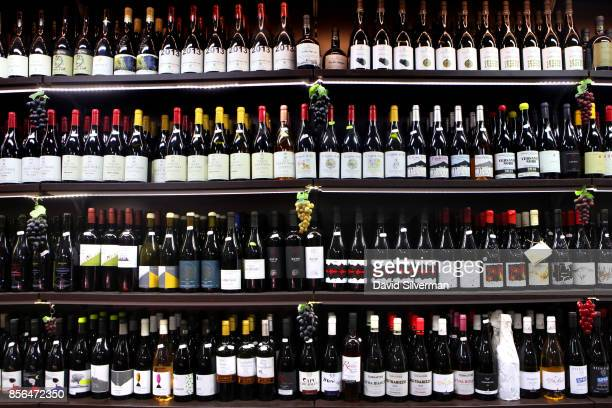 The shelves are filled with Etna DOC and other Sicilian wines at the Il Buongustaio dell'Etna wine bar on September 21 2017 in the village of...