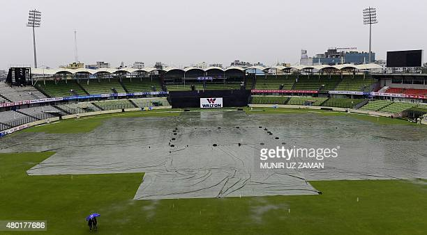 The ShereBangla National Cricket Stadium is covered as rain comes in during the first One Day International cricket match between Bangladesh and...