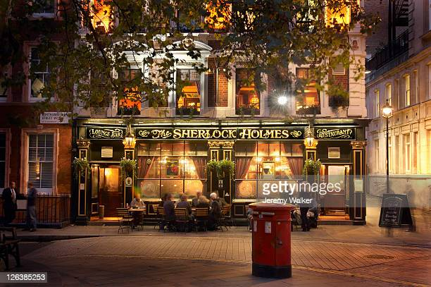 The Sherlock Holmes Pub illuminated at night in Northumberland street, London.