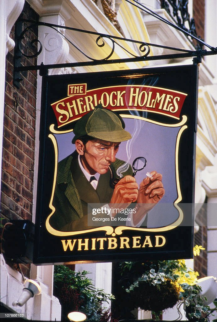 The Sherlock Holmes pub in Northumberland Street, in London's Westminster, 8th December 1986. The pub sign features actor Peter Cushing in the role of the famous fictional detective.
