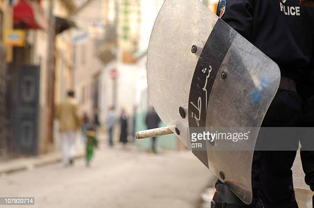The shield of a riot police member is pictured during clashes on January 7 2011 in central Oran some 430 kilometres west of Algiers Clerics called...