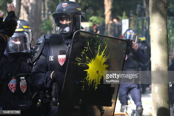 The shield of an Anti riot gendarme received a paint attack during a rally called by several French workers unions on October 9 2018 in Paris as part...