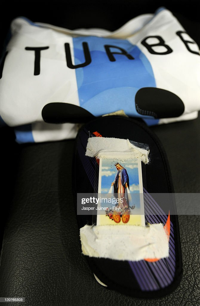 The Shin guards of Argentina player Juan Iturbe with a picture of Virgin Mary taped to it lay ready in the dressing room prior to the FIFA U-20 World Cup Colombia 2011 round of 16 match between Argentina and Egypt at the Atanasio Girardot stadium on August 9, 2011 in Medellin, Colombia.