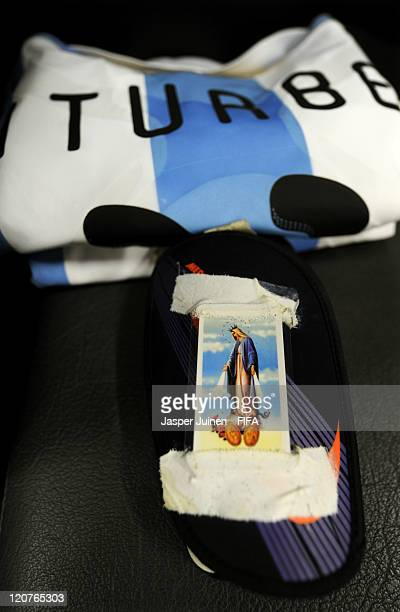 The Shin guards of Argentina player Juan Iturbe with a picture of Virgin Mary taped to it lay ready in the dressing room prior to the FIFA U20 World...