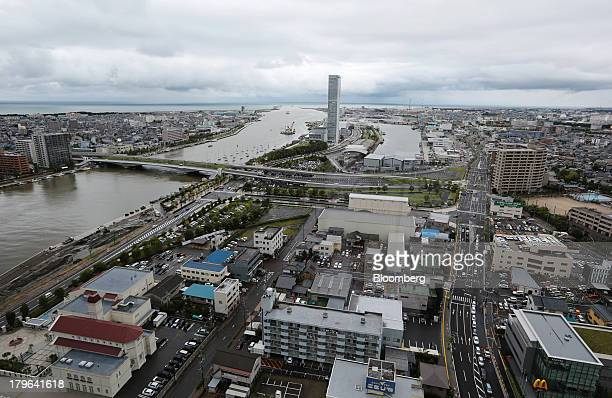 The Shinano river flows past buildings standing in Niigata Japan on Thursday Sept 5 2013 A government report on Sept 9 is forecast by economists...