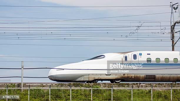 The Shinkansen speeding through the Japanese countryside