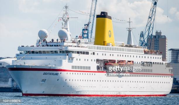 The ship 'MS Deutschland' made famous by the television series 'Das Traumschiff' takes off for its last cruise trip under German command in Kiel...
