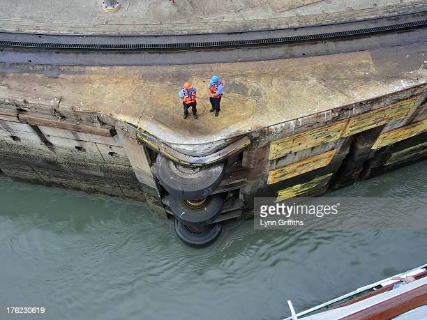 The ship enters Miraflores Lock. The rubber helps protect the ship from hitting the side although the paint scratched lock doors show plenty of ships...