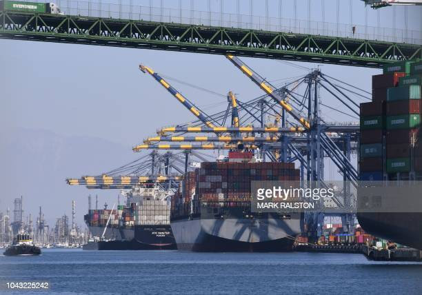 The ship Hammersmith Bridge which has just arrived from Shanghai in China unloads Chinese shipping containers at the Port of Long Beach in Los...