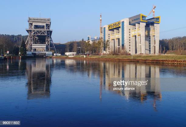 The ship lift currently being constructed as well as the old lift to the left can be seen in Niederfinow Germany 15 January 2018 The old ship lift in...