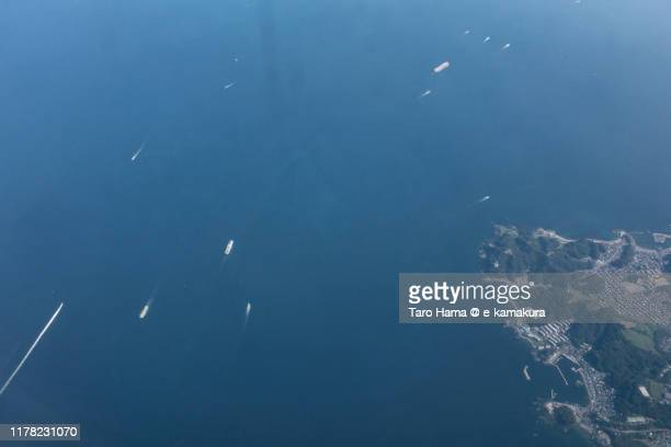 the ships sailing on tokyo bay in japan daytime aerial view from airplane - 太平洋 ストックフォトと画像