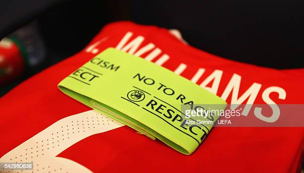 The shirt and the captain's armband worn by Ashley Williams of Wales are seen in the dressing room priro to the UEFA EURO 2016 round of 16 match...
