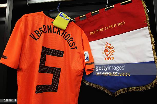 The shirt of Giovanni Van Bronckhorst of the Netherlands hangs next to the pennant of Netherlands in the dressing room ahead of the during the 2010...