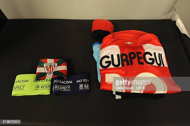 The shirt of team captain Carlos Gurpegi of Athletic Bilbao is laid out with the Basque flag and the UEFA ''No to Racism'' armband in the dressing...