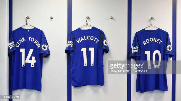 The shirt of Theo Walcott Cenk Tosun and Wayne Rooney hang in the Everton dressing room before the Premier League match between Everton and West...