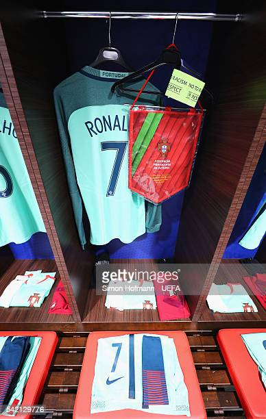 The shirts worn by Cristiano Ronaldo of Portugal is hung with the matchday pennant and captain's armband in the dressing room prior to the UEFA EURO...
