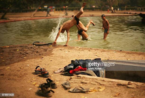 The shoes and clothes of a group of local boys swimming in a pond next to India Gate are seen on March 18 2010 in Delhi India