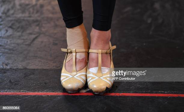 The shoes are seen from one of the Radio City Rockettes during rehearsals in New York October 12 2017 for the 2017 Christmas Spectacular Starring the...