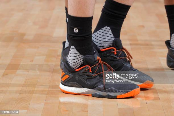 The shoes belonging to Dragan Bender of the Phoenix Suns in a game against the Sacramento Kings on April 11 2017 at Golden 1 Center in Sacramento...
