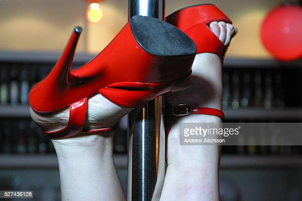 The shoes of a woman upside down during pole dancing class held at a central London pub