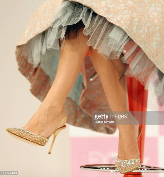 The shoes of actress Sarah Jessica Parker are seen as she attends a press conference to promote the DVD release of the final season of 'Sex and the...
