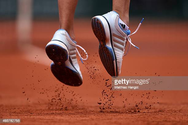 The shoes of Alize Lim of France as she serves during her women's singles match against Serena Williams of the United States of America on day one of...