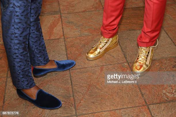 The shoes of Andrew Wiggins of the Minnesota Timberwolves and Joel Embiid of the Philadelphia 76ers during the 2017 NBA Draft Lottery at the New York...