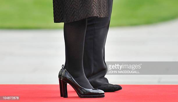 The shoes of Argentina's President Cristina Fernandez de Kirchner and German Chancellor Angela Merkel are seen as they listen to their national...