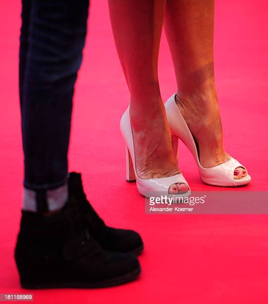 The shoes of German TV presenter Barbara Schoeneberger are seen during the red carpet prior the Ferrero kinderTag 2013 event at Heidepark on...