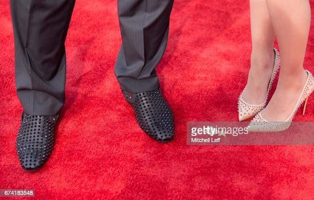 The shoes of Jonathan Allen of Alabama and finance Hannah Franklin on the red carpet prior to the start of the 2017 NFL Draft on April 27, 2017 in...