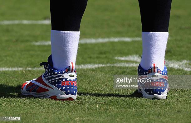 """The shoes of Matt Hasselbeck of the Tennessee Titans with the words """"NEVER FORGET"""" remembering the 9/11 attacks are worn ahead of their game against..."""
