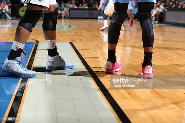 The shoes of Maya Moore of the Minnesota Lynx and Angel McCoughtry of the Atlanta Dream are seen during the game on July 31 2015 at Target Center in...