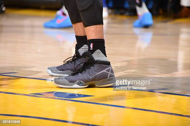 The shoes of Russell Westbrook of the Oklahoma City Thunder are seen during the game against the Golden State Warriors in Game One of the Western...