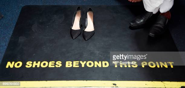 TOPSHOT The shoes of Scotland's First Minister and Scottish National Party leader Nicola Sturgeon are pictured during her visit to Dundee Central...