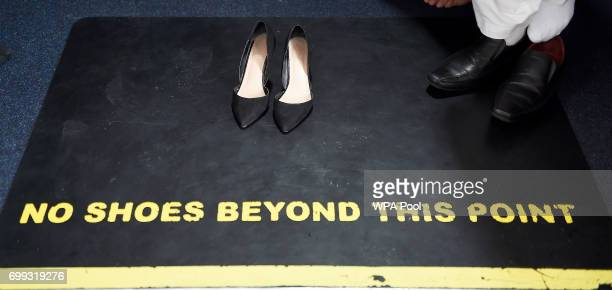 The shoes of Scotland's First Minister and Scottish National Party leader Nicola Sturgeon are pictured during her visit to Dundee Central Mosque on...